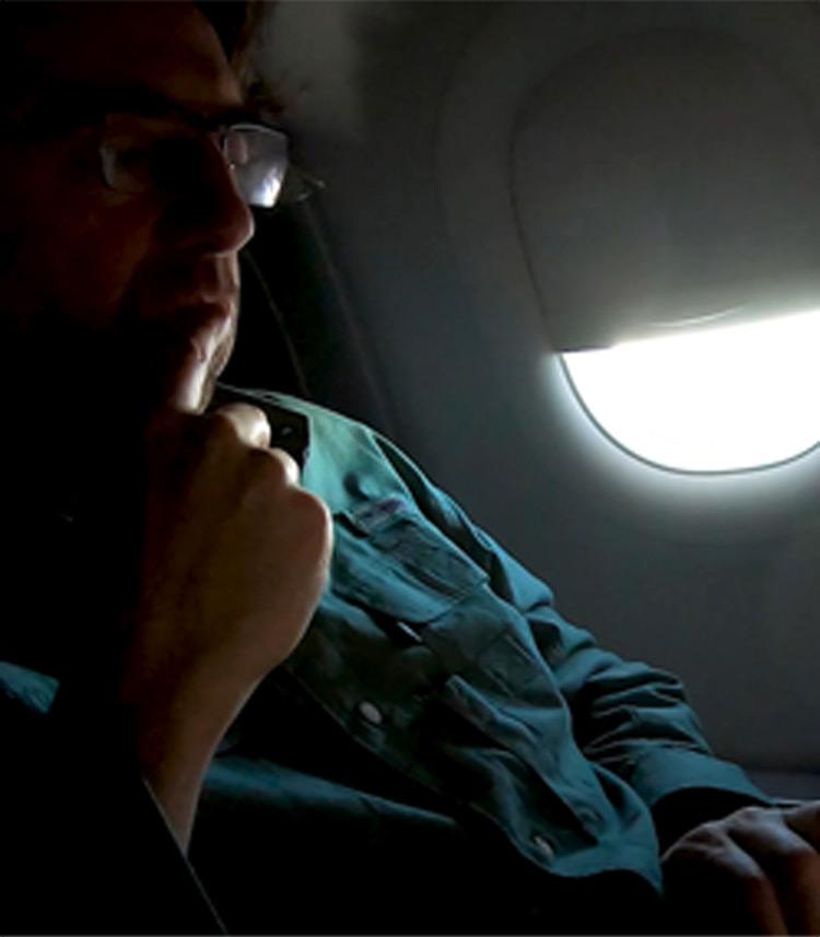 Director Joel Gilbert on the plane to Tallahassee to meet Diamond.